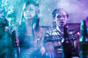 alcoholic-shutter219594313-teens-smoking-and-drinking-at-party