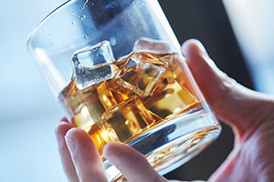 alcoholic-shutter231807016-hand-holding-glass-of-alcohol